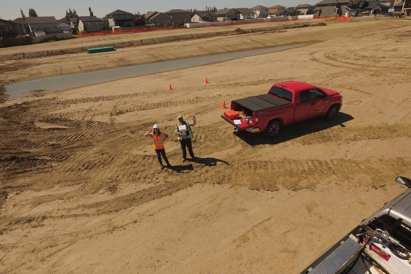Scheffer Andrew surveying a development site with a drone